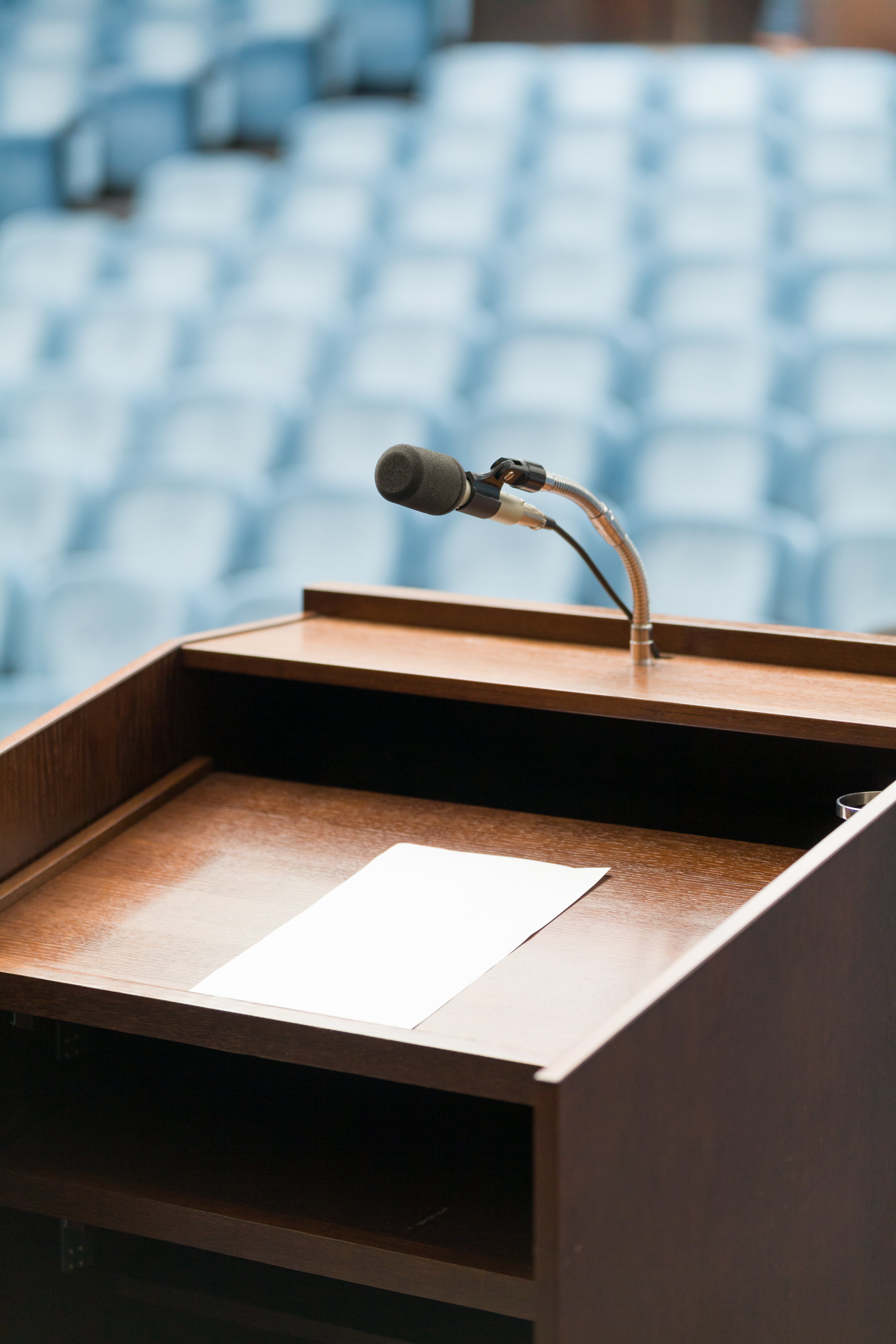 Communications Consultant Services in Plano, TX | Speaker's table with paper